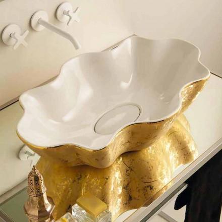 Lavabo design d'appui en céramique blanc et or, fait en Italie Cubo