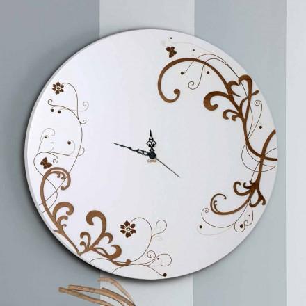 Horloge murale en bois moderne et ronde avec des décors de design saisonniers
